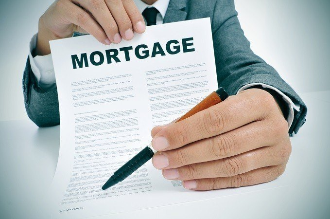 Man with Mortgage contract