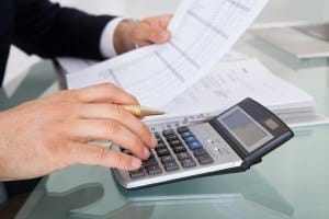Businessman Calculating Expenses